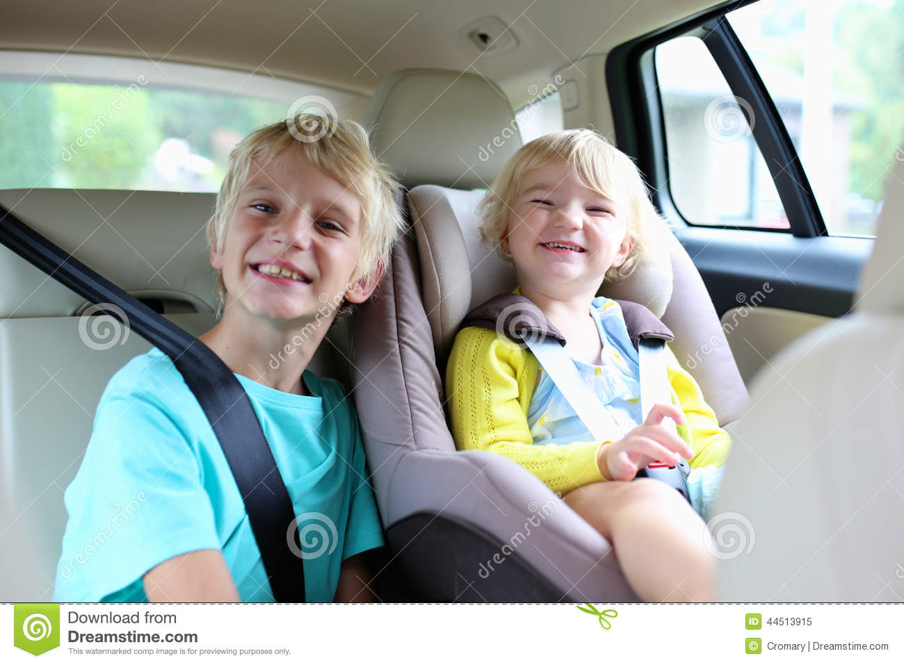 Brother and sister in car